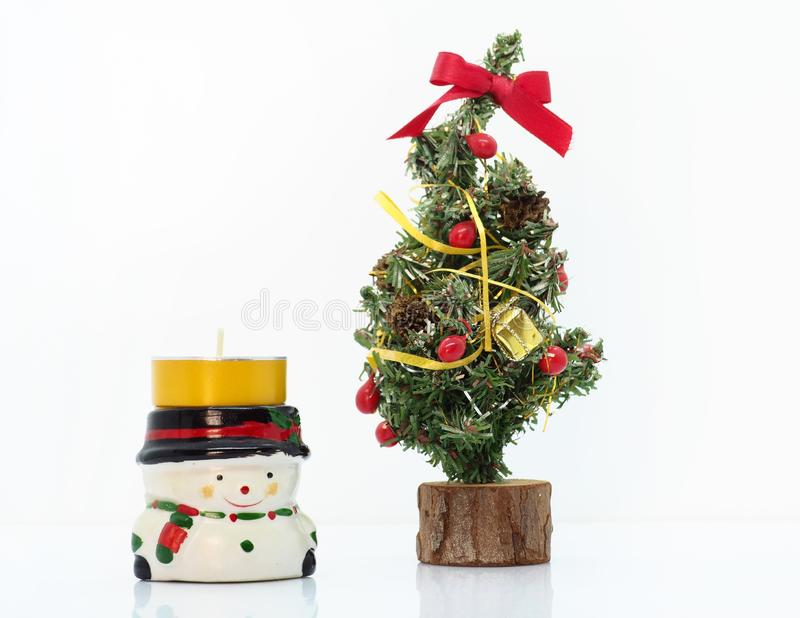 Christmas composition,snowman and a small christmas tree stock photo