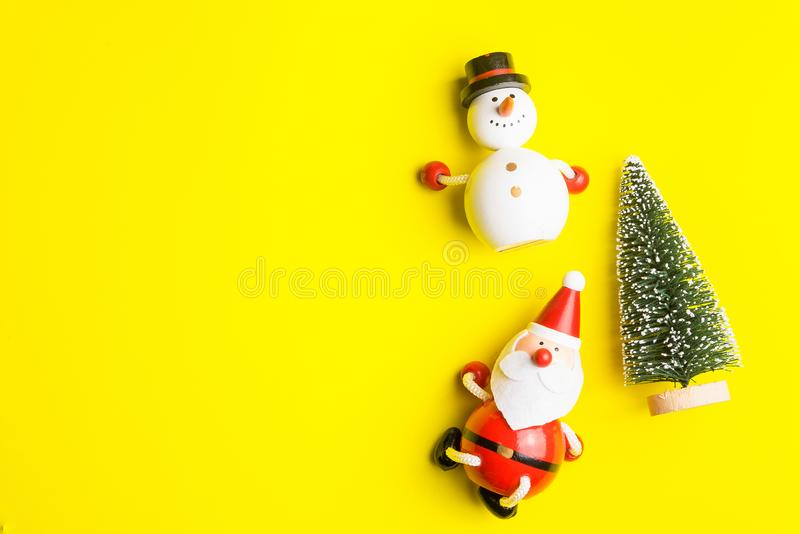 Small snowman and Small Santa Claus on yellow background at Christmas day.Theme Christmas day background. stock photography