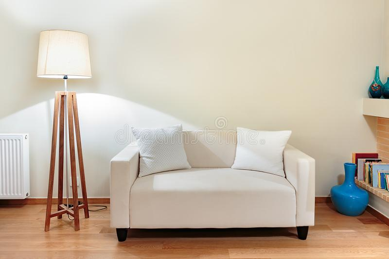 Small sofa with two little pillows. royalty free stock photos