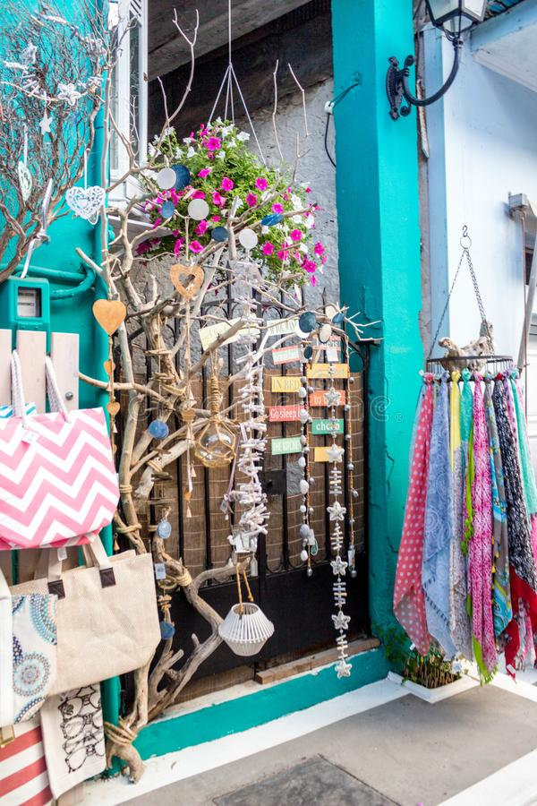 Small souvenir shop, including wooden handicrafts, bags, scarfs, an historic town in Northern Greece. royalty free stock image