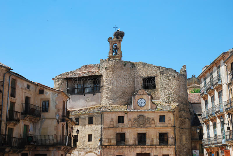 Small Spanish village with stork nest at the top of a church royalty free stock images