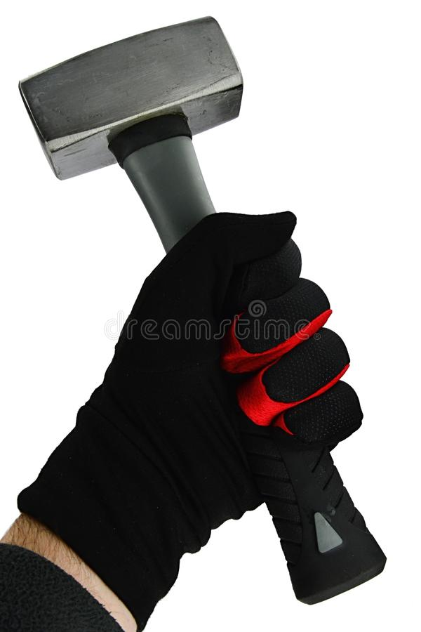 Small square shaped steel hammer held in left hand in black nylon glove with thin red outline, white background royalty free stock photography