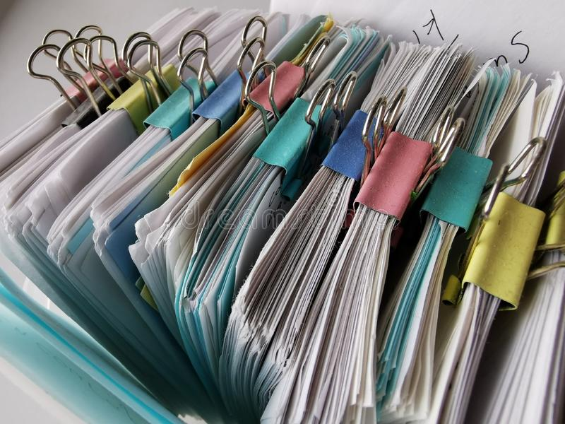 Small Square Sheets of Paper with a Curved Edges and Metal Binder Clips.  stock illustration