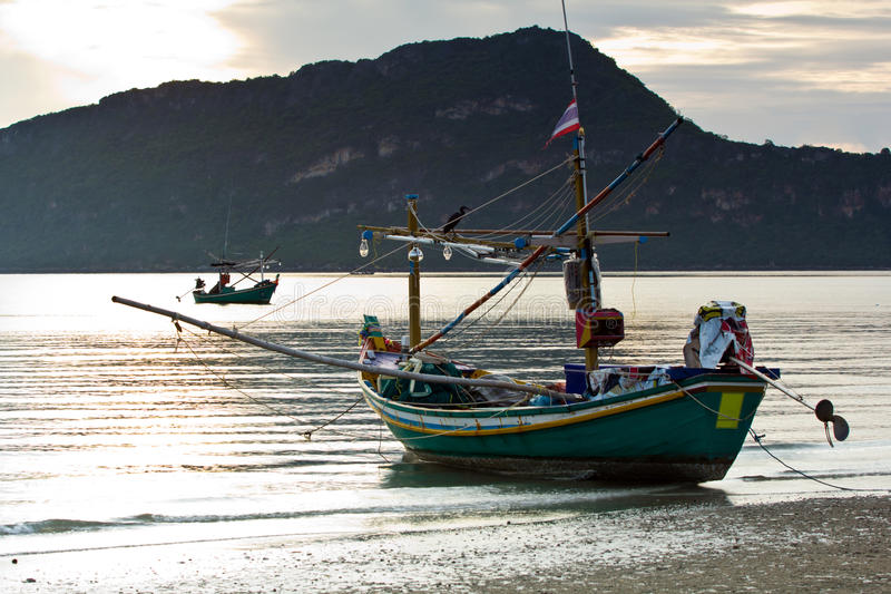 Small squid fishing boat at pranburi beach in the