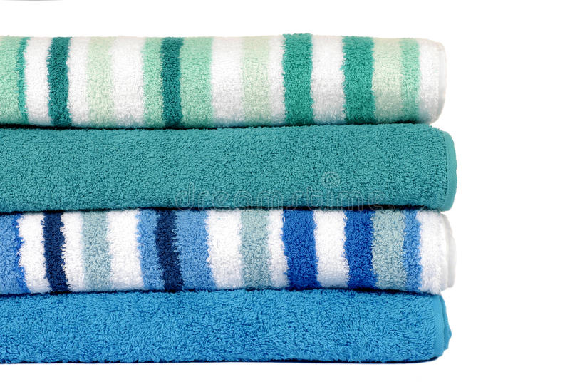 Small stack of beach or bathroom towels isolated on white background. Small stack of bathroom towels isolated on white background royalty free stock image