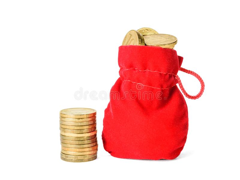 Small stack of coins and pouch with coins isolated on white background. The concept of saving cash savings stock photo
