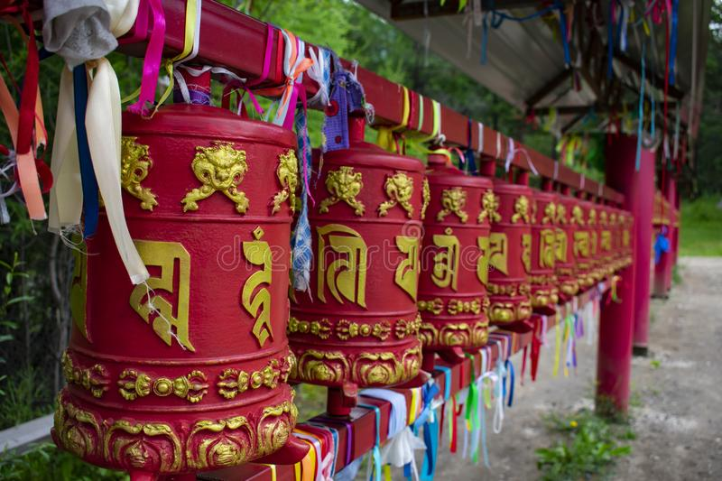 Small stationary metal drums on Buddhist square stock photo