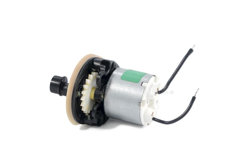 Small stepper motor. Small metal stepper motor with protruding wires on white background royalty free stock image