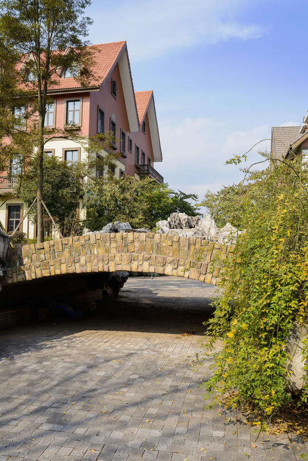 Small stone bridge in exotic European style town at sunny winter royalty free stock photography