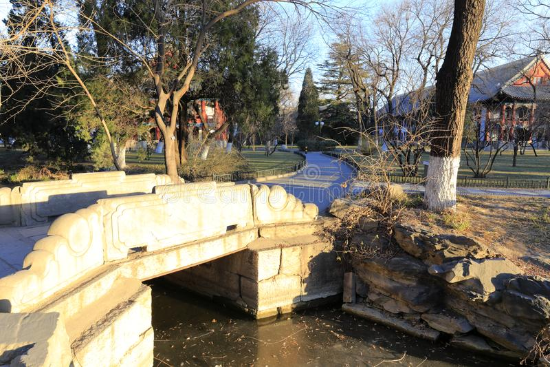 Small stone bridge of frozen weiminghu lake in peking university, adobe rgb royalty free stock images