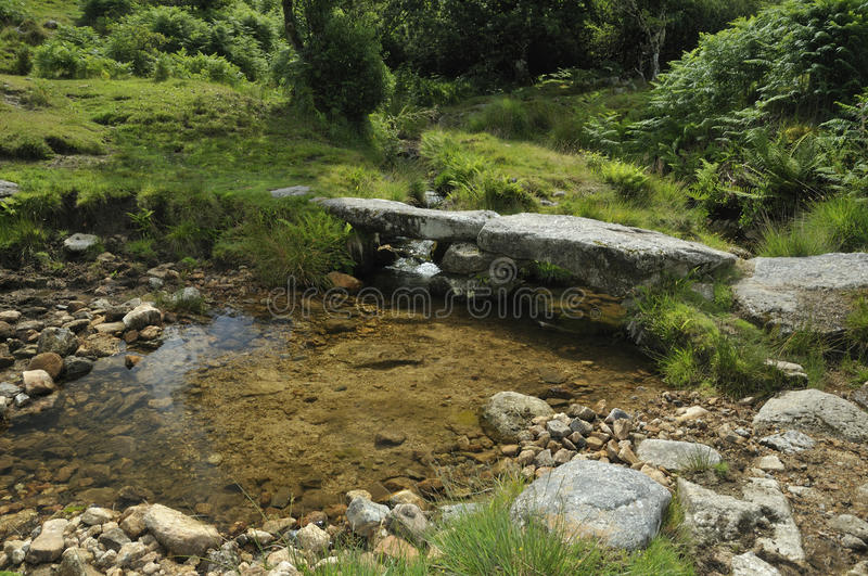 Small stone Clapper Bridge. Over stream near Combestone Tor, Dartmoor stock photo