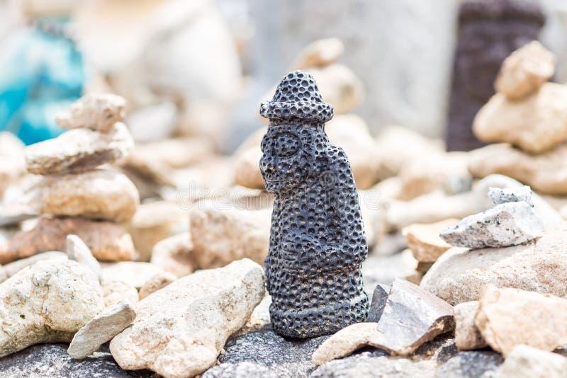 Small stone figure of hareubang Jeju island idol , shot in prayer place of buddist temple South Korea stock images