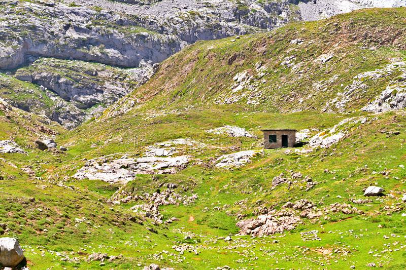 The small stone hut in mountains. royalty free stock photography