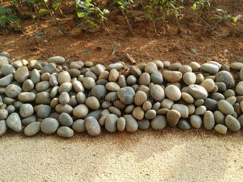 Small stone isolated on garden royalty free stock photos