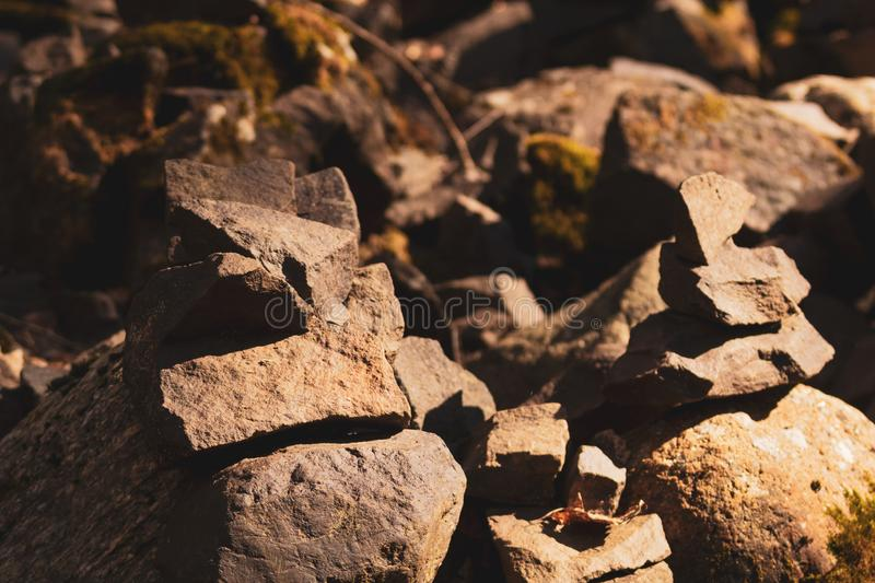 Small stone turrets in the forest. stone sculptures. Background, natural, nature, rock, balance, belief, believing, build, builder, handmade, hard, harmony royalty free stock photo