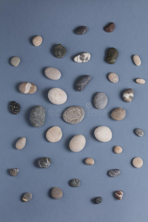 Small stones for feet massage stock photos