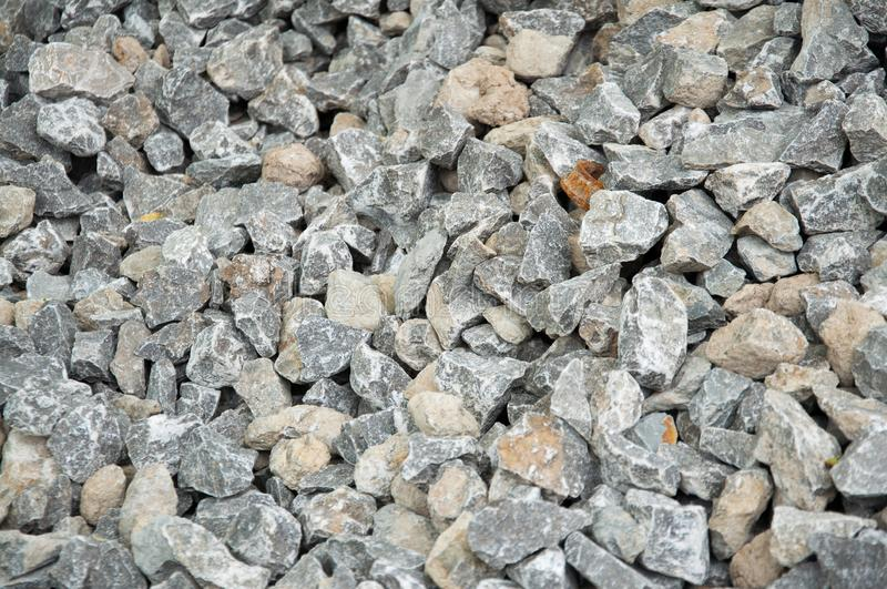 Small stones on the heap. Crushed stone stock photos