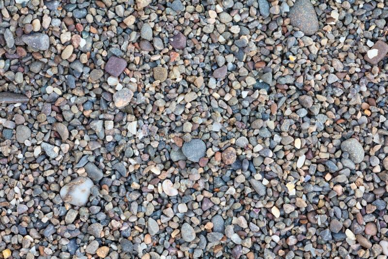Small stones pebbles sand background stock photo