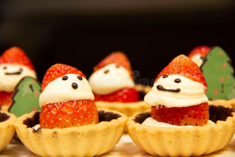 Small strawberry tart Santa dessert stock photos
