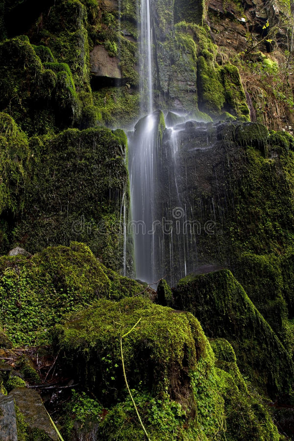 Small stream of falling water at Melincourt Waterfall. Melincourt waterfall, Resolven, Vale of Neath, South Wales royalty free stock photography