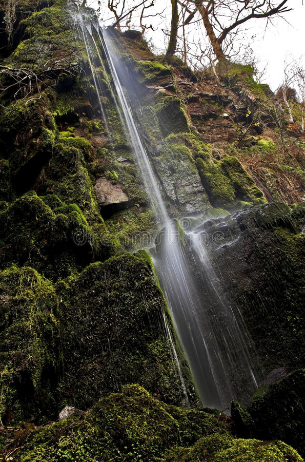Small stream of falling water at Melincourt Waterfall. Melincourt waterfall, Resolven, Vale of Neath, South Wales stock photography