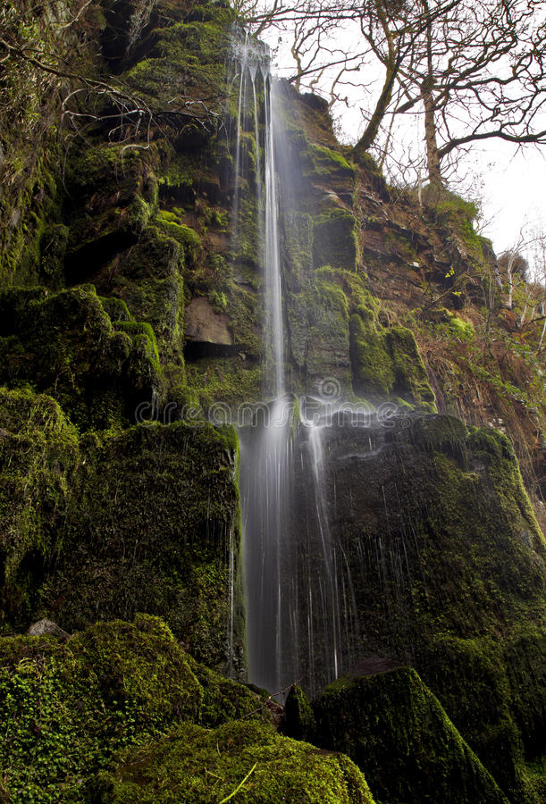 Small stream of falling water at Melincourt Waterfall. Melincourt waterfall, Resolven, Vale of Neath, South Wales royalty free stock images