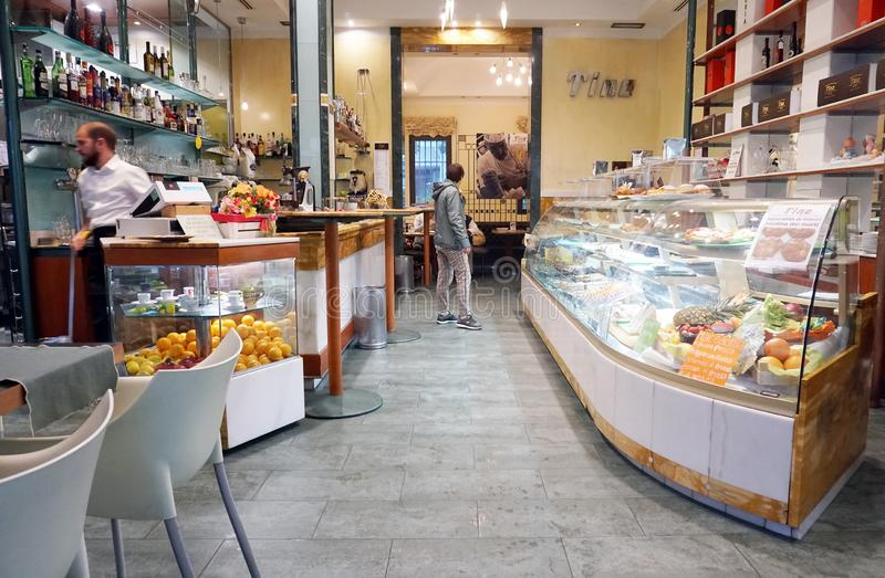 Small street cafe with a large entrance directly from the street. RIMINI, ITALY, SEPTEMBER 23, 2019. Small street cafe with a large entrance directly from the royalty free stock photo