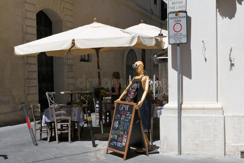Valletta, Malta, August 2019. Interior of a street cafe with a funny mannequin. royalty free stock image