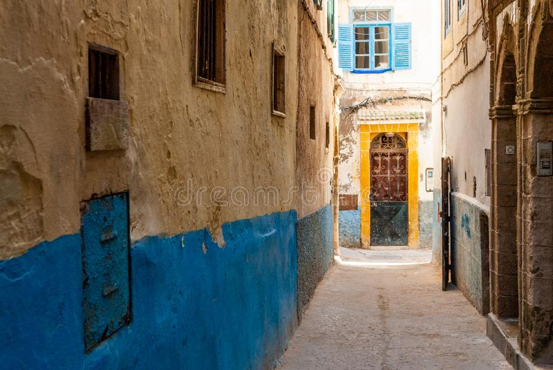Mellah district in the medina of Essaouira. A small street in the medina of Essaouira in Morocco. The bottom of the walls is painted in blue stock photos