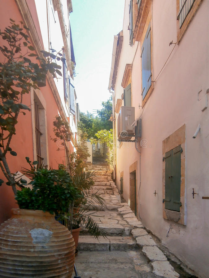 Small street in pink, Greece stock images
