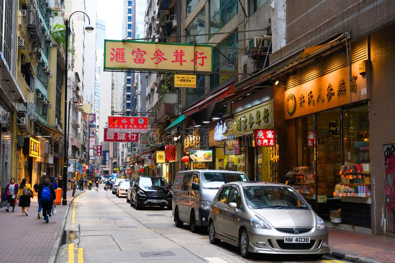 Small street with shops and restaurants in Hong Kong Island, China royalty free stock photography