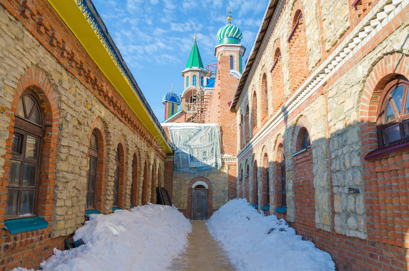 A small street with views of the mosque. Kazan, Republic of Tatarstan, Russia - February 13, 2016: Settlement Old Arakchino. The temple of all religions. The stock photo
