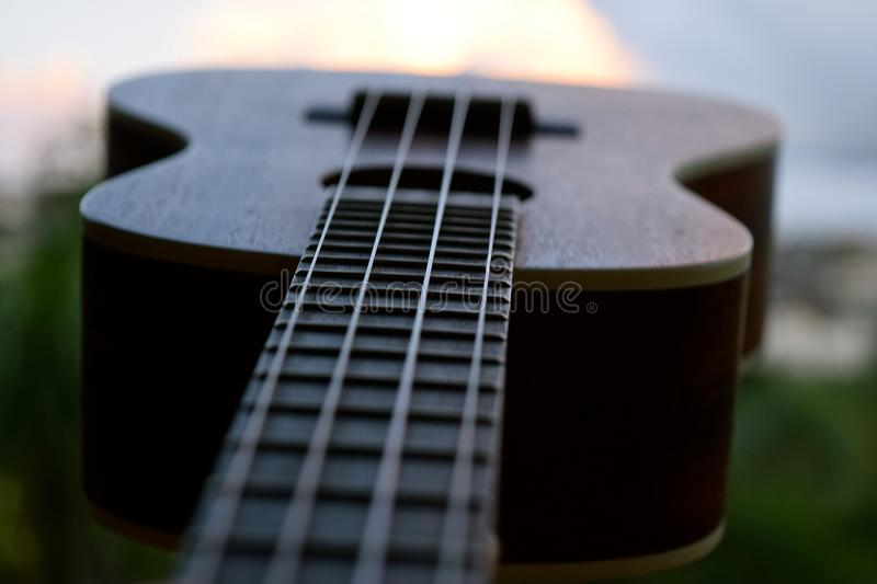 Ukulele Closeup. A small 4 stringed musical instrument that was popularized when it was introduced to Hawaii stock photos