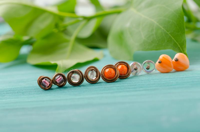 Small stud earrings. Handmade copper wire and beads jewelry royalty free stock photo