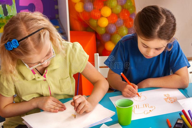 Small students children painting in art school class. Painting ideas for children. Small students painting in art school class. Child drawing by paints on table stock photos