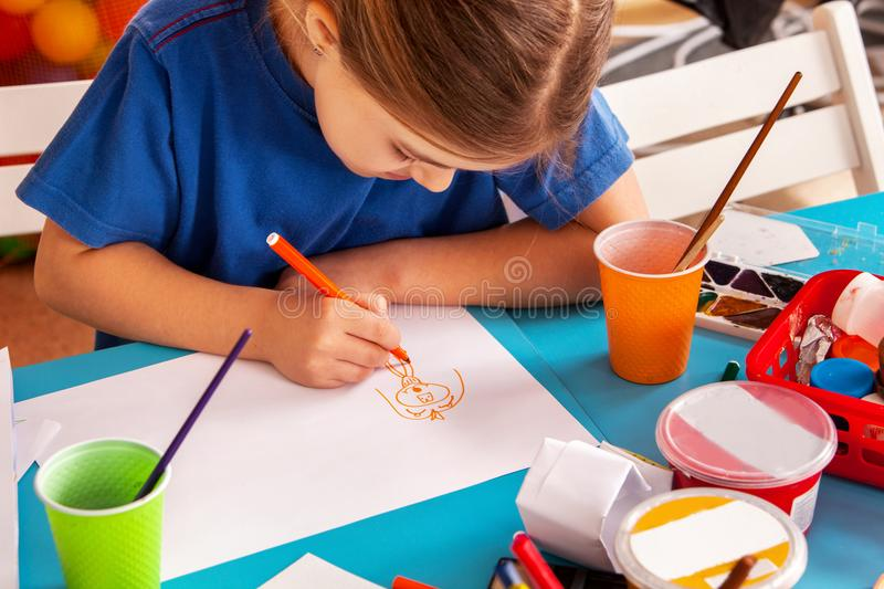 Small students children painting in art school class. Small students painting in art school class. Child drawing by paints on table. Boy and girls in royalty free stock photography