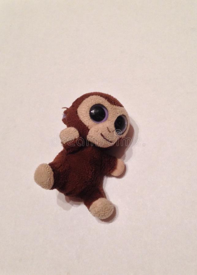 Small Stuffed Monkey on a White Background stock images