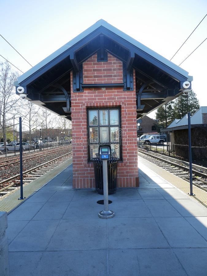 Small suburban train station in California. Bay Area, in City of Campbell. Narrow building to provide shelter from Sun or Rain stock images