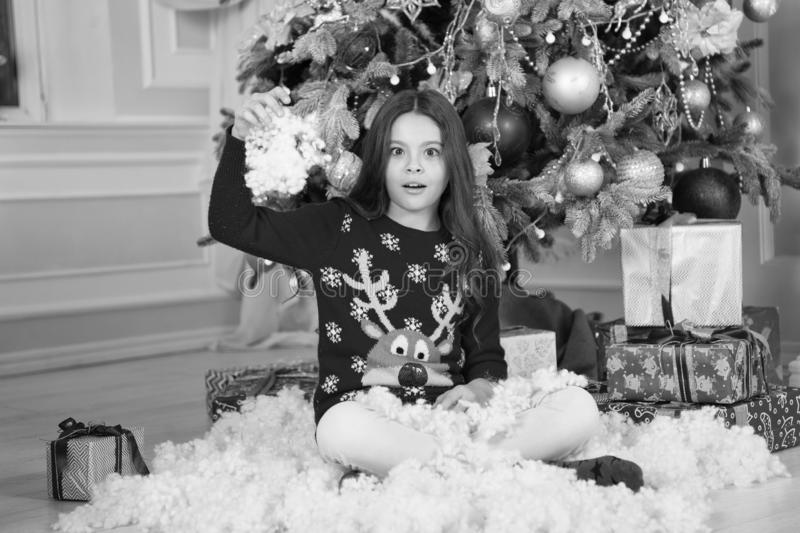 Small surprised girl at christmas. Christmas. Kid enjoy the holiday. Happy new year. The morning before Xmas. New year. Holiday. little child girl likes xmas royalty free stock images