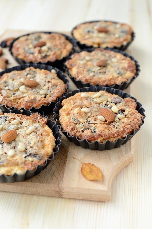 Small Tarts With Nut Filling On A Wooden Board. Stock Photo