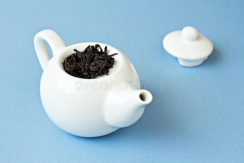 Download Small Tea Pot With Leaves Of Black Tea Stock Image - Image of background, breakfast: 26569859