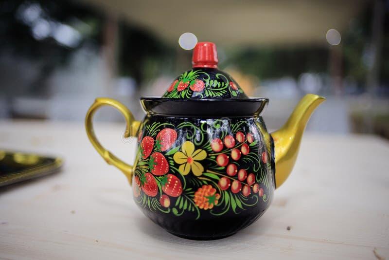 Small tea pot. On table royalty free stock photos