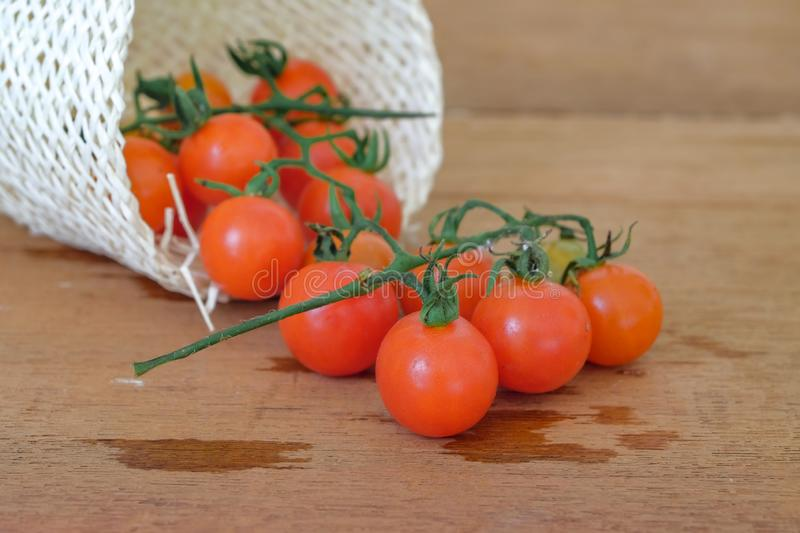 Small Tomato spill out of basket.Food. Concept stock image