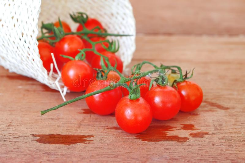 Small Tomato spill out of basket.Food. Concept royalty free stock images