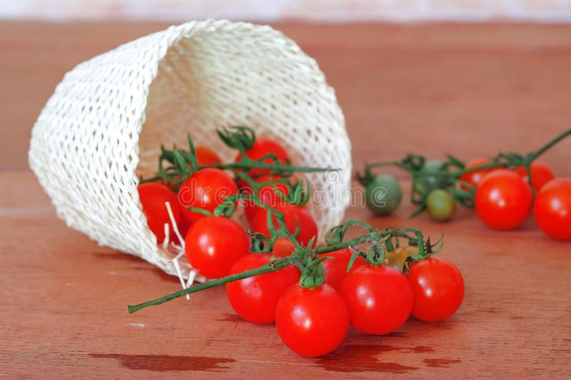Small Tomato spill out of basket.Food. Concept stock images