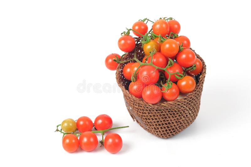 Small Tomato spill out of basket.Food. Concept stock photos