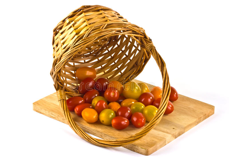 Download Small tomatoes in a basket stock photo. Image of green - 26469732