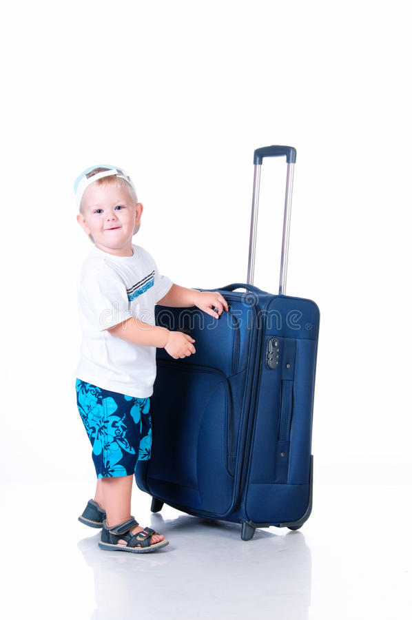 Small Tourist With Suitcase On White Background Stock Photography
