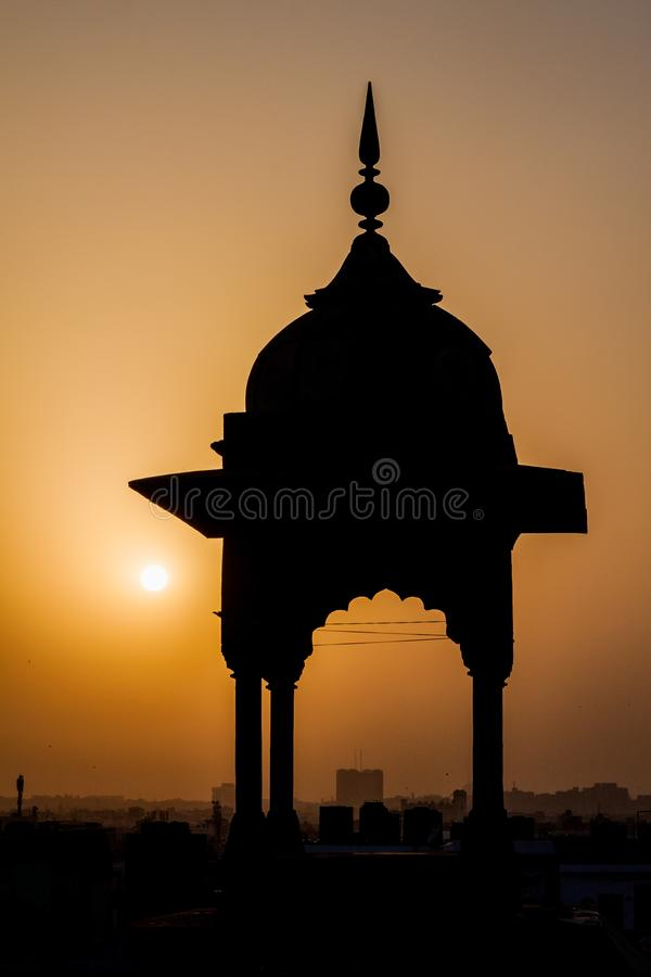 Small tower of Jama Masjid mosque in the center of Delhi during sunset, Indi. A stock image