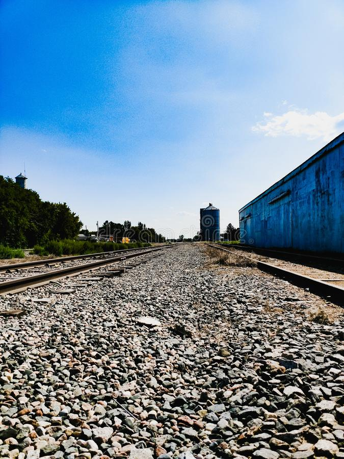Small Town Abandoned Railroad Tracks. Old forgotten railroad tracks in small town usa stock photography